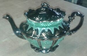 VINTAGE VERY ORNATE BLACK AND GREEN TEAPOT.                             A11