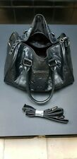 Weekend bag with shoulder strap, black simulated leather embossed with skulls.