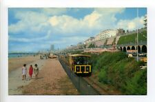 England, Brighton, Volk's Railway, railroad, women on beach, retro clothes 60's?