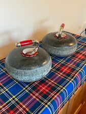 A Stunning pair of Scots Black Granite outdoor Curling Stones with Red Handles