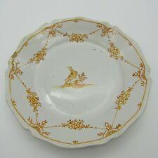 Nevers. Assiette en faïence décor d'un oiseau en camaïeu jaune, XVIIIe siècle
