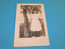 Vintage Old RPPC Photo Postcard Young Victorian Girl Standing on a Tree Swing