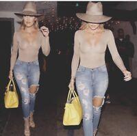 Fashion Nova Cut Out Ripped High Waisted Jeans seen on Khloe Kardashian