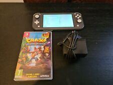 Nintendo Switch Lite Console Grey + Crash Bandicoot Trilogy + Charger. GC.