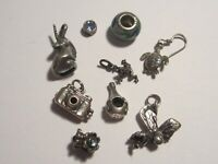 Lot of  9 Sterling Silver Charms/Pendants