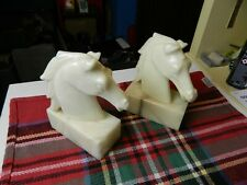pair of white marble horse head bookends