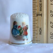 AVON Porcelain Christmas Thimble Girl and Boy Exchanging Gifts 1984