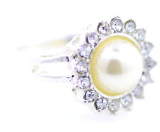 Silver ring with pearl centre and crystals surrounding in a sunflower deign