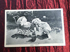 SHIRLEY TEMPLE - WITH DOLL IN PRAM - FILM STAR  - BLACK AND WHITE POSTCARD - VG