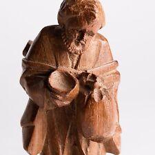 Hand Carved wooden man traveler