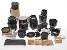 Nikon, big lot various accessories; filters, caps, screens, sold as is....