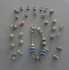 LOT - STERLING 925 CHARM BRACELET W/ ASSORTED CHARMS - 78 GR - BEING SOLD AS IS