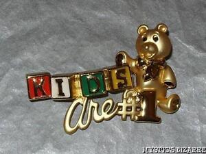 VINTAGE 80'S DANECRAFT GOLD TONE ENAMEL KIDS ARE NO 1 TEDDY BLOCKS BROOCH UNWORN