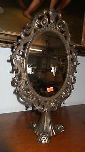 A vintage , metal, antique style table mirror