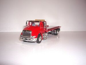 SPECCAST 1/64 RED INTERNATIONAL 8600 SINGLE AXLE ROLLBACK FLATBED DCP