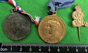 Two 1911 GVR Royal Coronation medals. Victoria & West Australia + GVR stick pin.