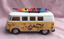 KINSMART Volkswagen Classical Bus peach with details on sides, surf board roof.