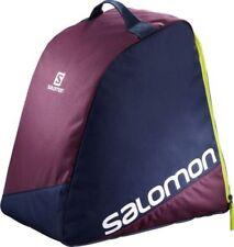 Équipements de neige verts Salomon pour les sports d'hiver