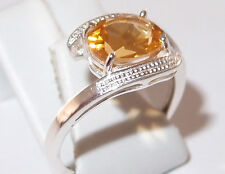 Oval Citrine twist solitaire in rhodium plated Sterling Silver, 1.75ct. Size O.