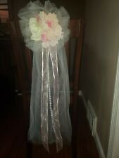 Six light pink and ivory artificial flower hanging pew, chair, decorations.
