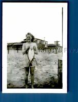 FOUND B&W PHOTO N+3008 PRETTY WOMAN IN DRESS POSED ON BEACH HOLDING FISH