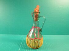 Small Green Glass Oil/Vinegar Pitcher with Red Trim Netting And Straw Stopper