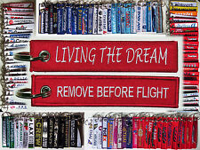Keyring Living The Dream Remove Before Flight style tag