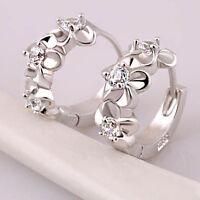 LC_ donna Camellia FIORE INTAGLIATI ZIRCONE stretto orecchio clip a cerchio