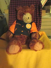 Dave and Buster's Plush Bear With Logo Wearing Navy Orange Winner Varsity Jacket