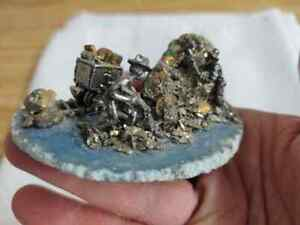 Pewter/pyrite sculpture on agate base..