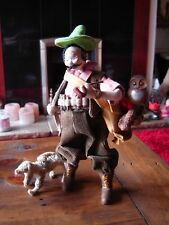 """Vintage Klumpe Made in Spain hunter doll. 10 1/2"""" tall. No. 1615. With his dog."""