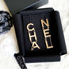 CHANEL CHA NEL GOLD LOGO DANGLE EARRINGS SOLD OUT BNIB RUNAWAY 2019 with receipt