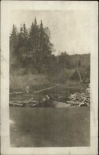Logs in River 1919 Oakfield ME Cancel Real Photo Postcard