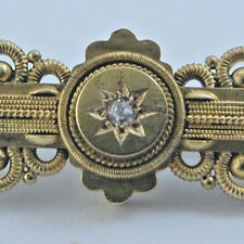Gold Victorian 15 carat diamond brooch 4.1 grams with a gold pin.