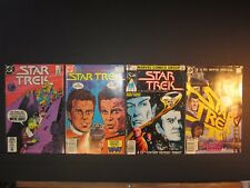 4 Star Trek DC comics, #6, #26, #1 The Motion Picture, #2 IV The Voyage Home