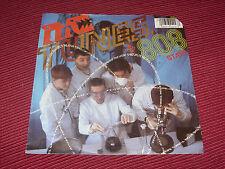 "MC Tunes & 808 State: Tunes splits the atom  1990    EX  UK  7"""