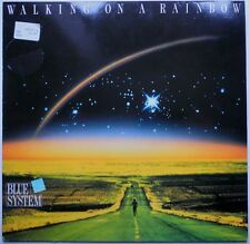LP DE**BLUE SYSTEM - WALKING ON A RAINBOW (HANSA '87 / CLUB EDITION)**25489
