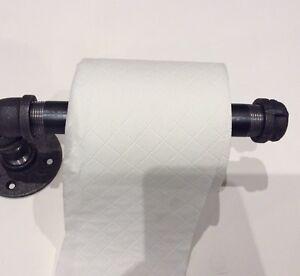 Toilet paper holder handmade of industrial glavanised iron.