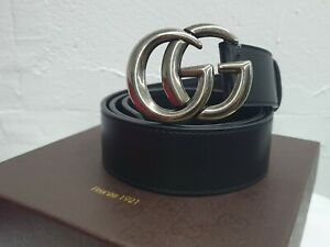 Gucci black belt with silver tone buckle