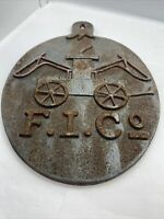 Fire Mark F.I. Co Fireman Cast Iron Insurance Plaque Featuring Vintage Wagon