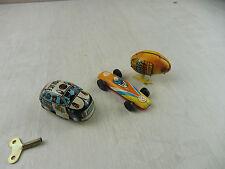 Lot de jouets en tôle mécanique, poule, voiture police et course