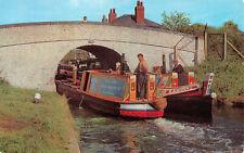 R243805 Britains Inland Waterways. Pair of Narrow boats entering Uxbridge Lock.