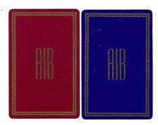 "2 single bridge size playing cards, swap/collect jokers, ""AIB"", burgandy, blue"
