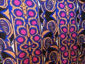 100% Rayon. Tropical Inspired Print with Hues of Fuchsia, Blue, Brown and Black