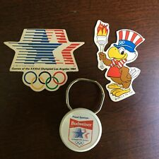 1980 & 1984 Olympic Games Collectibles 2 Magnetic Stick-on Logos & Bud Key Chain