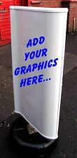 A Board Wind powered Spinning Pavement Sign with Graphics included