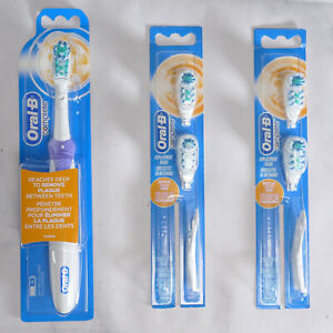 1 Oral-B Complete battery powered toothbrush with 4 replacement heads,(New)