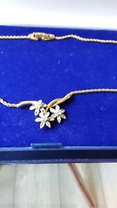 VINTAGE ATTWOOD AND SAWYER GOLD TONE NECKLACE WITH FACETED STONES