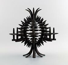 Jens H. Quistgaard 1919-2008. A circular, pineapple shaped candlestick of iron