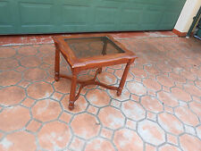 Glass and brown timber table